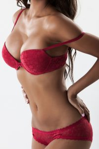 Body of sexy woman in red lingerie, side view
